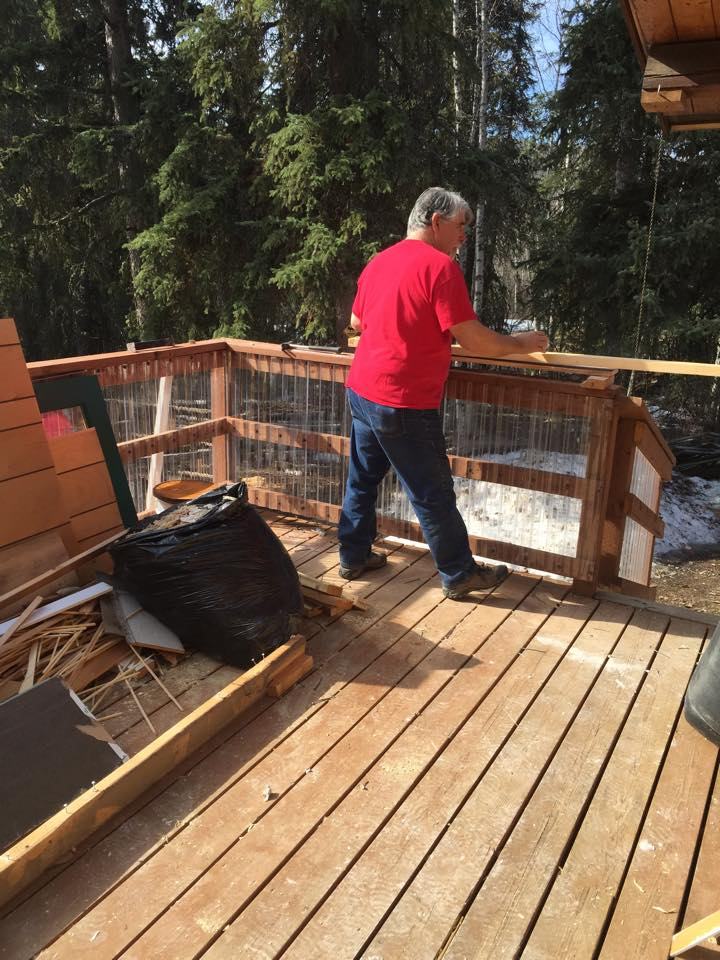 Mike Musick on the back porch during the work party at the Clausen Cabin April 17.