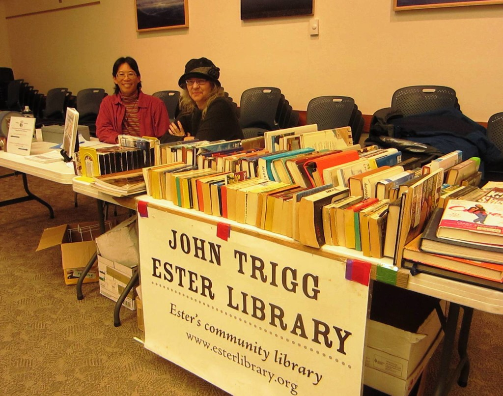 Board president Syrilyn Tong and JTEL volunteer Deirdre Helferich staff the sale table at the consortium book sale